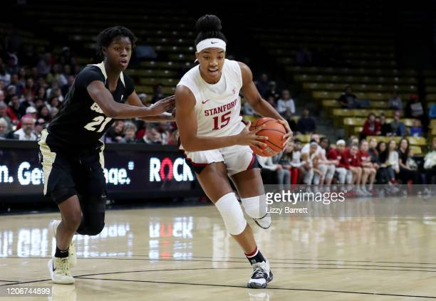 Maya Dodson of the Stanford Cardinal dribbles past the defense of Mya Hollingshed of the Colorado Buffaloes during the second quarter of a game...