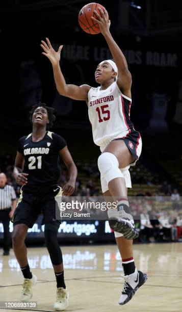 Maya Dodson of the Stanford Cardinal makes a lay up past the defense of Mya Hollingshed of the Colorado Buffaloes during the first quarter of a game...