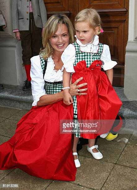 Maya Flick attends with her daughter Charlotta Flick the opera 'Carmen' at the Thurn und Taxis castle festival on July 11 in Regensburg Germany