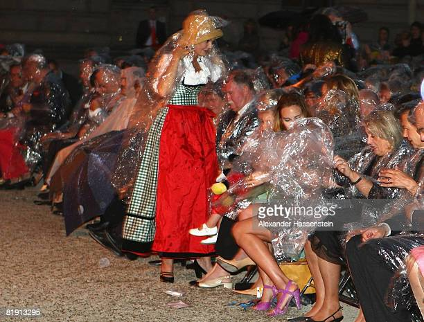 Maya Flick attends with rain coat the opera 'Carmen' at the Thurn und Taxis castle festival on July 11 in Regensburg Germany
