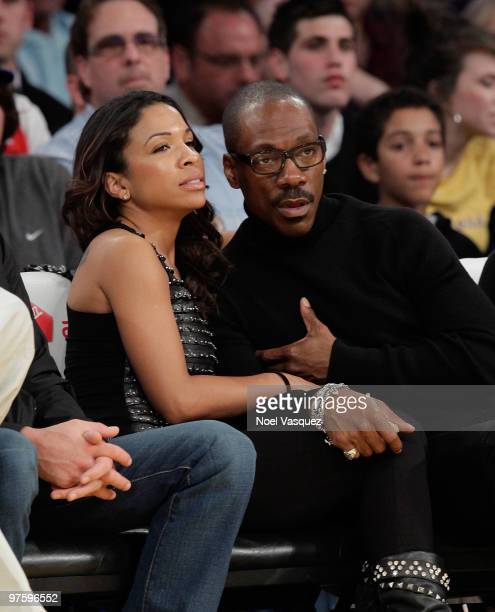 Maya Gilbert and actor Eddie Murphy attend a game between the Toronto Raptors and the Los Angeles Lakers at Staples Center on March 9 2010 in Los...