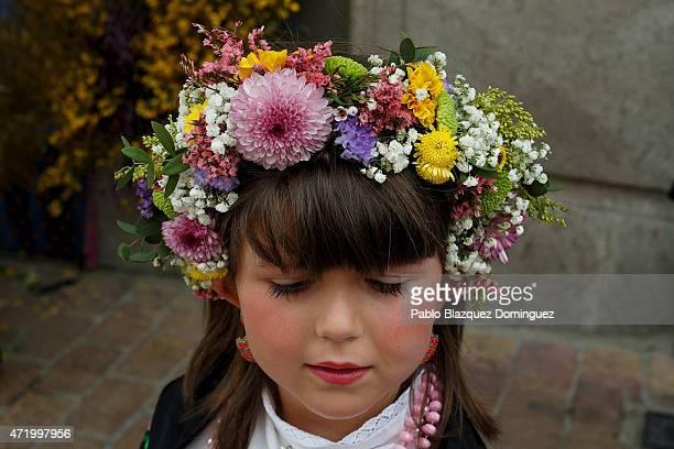 Maya girl wears a flowers crown during 'La Maya' tradition in the streets on May 2 2015 in Colmenar Viejo near Madrid Spain 'La Maya' festivity is a...