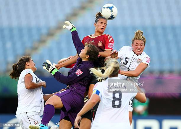 Maya Hayes of USA and Lena Lotzen of Germany head for the ball during the FIFA U20 Women's World Cup 2012 group D match between USA and Germany at...