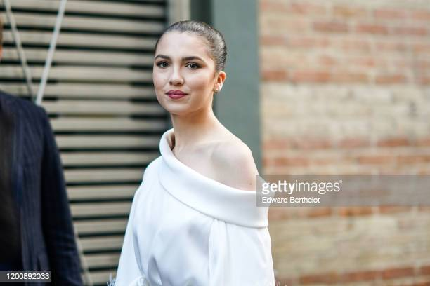 Maya Henry wears earrings a white oneshoulder top outside Ralph Russo during Paris Fashion Week Haute Couture Spring/Summer 2020 on January 20 2020...