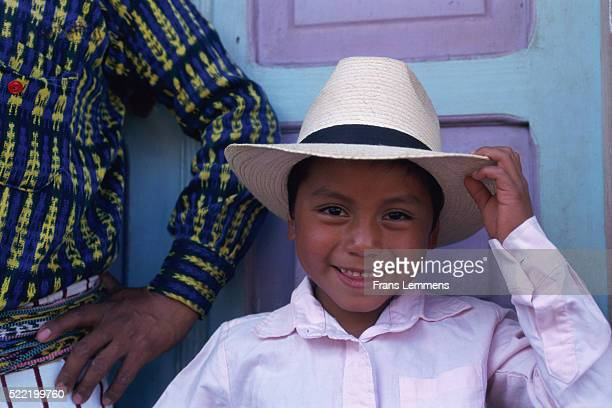 Maya indian boy and father in front of door, Guatemala