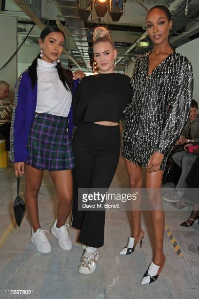 Maya Jama AnneMarie and Jourdan Dunn attend the Christopher Kane show during London Fashion Week February 2019 on February 18 2019 in London England