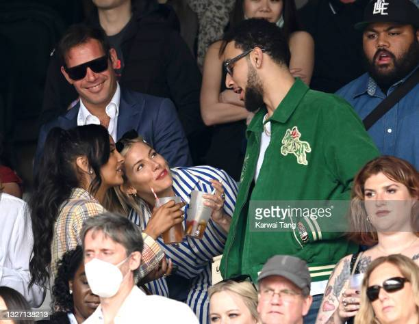 Maya Jama, Sienna Miller and Ben Simmons attend day 7 of the Wimbledon Tennis Championships at the All England Lawn Tennis and Croquet Club on July...