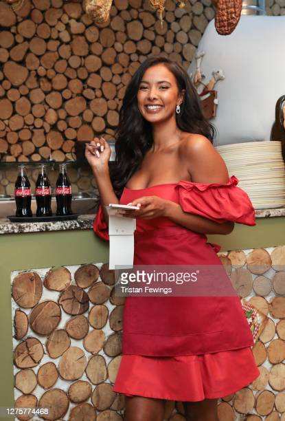 Maya Jama surprises a fan for a socially-distanced lunch date to celebrate Coca-Cola's Open Like Never Before campaign on September 21, 2020 in...