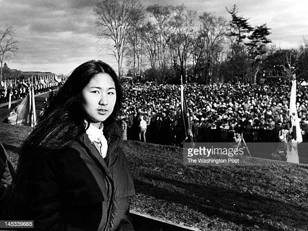 Maya Lin architect of the Vietnam Memorial stands during the dedication on November 13 1982 A large crowd of friends and relatives of those who...