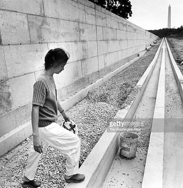 Maya Lin designer and architect of the Vietnam Memorial is shown visiting the construction site on July 12 1982