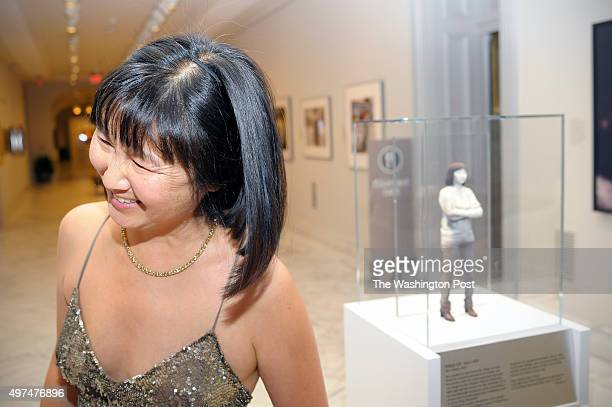 Maya Lin designer and artist who created the Vietnam Veterans Memorial on the National Mall chats near a sculpture of her at the National Portrait...