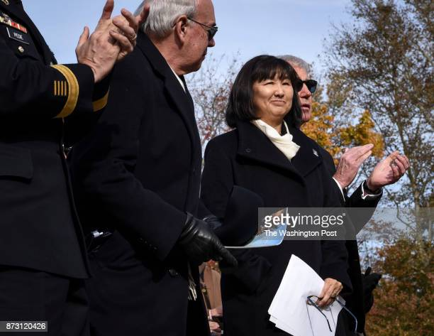 Maya Lin designer of the wall accepts a standing ovation during ceremonies to commemorate the 35th anniversary of the Vietnam Memorial on Veterans...