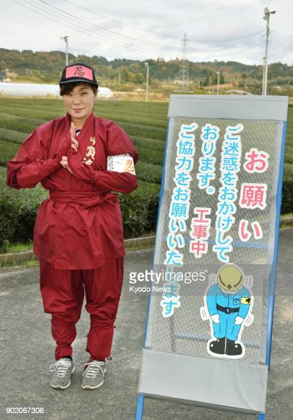 Maya Miyoshi head of security firm SCC Co in Koka Shiga Prefecture poses in her ninjastyle uniform on Nov 20 2017 SCC is enjoying success by dressing...
