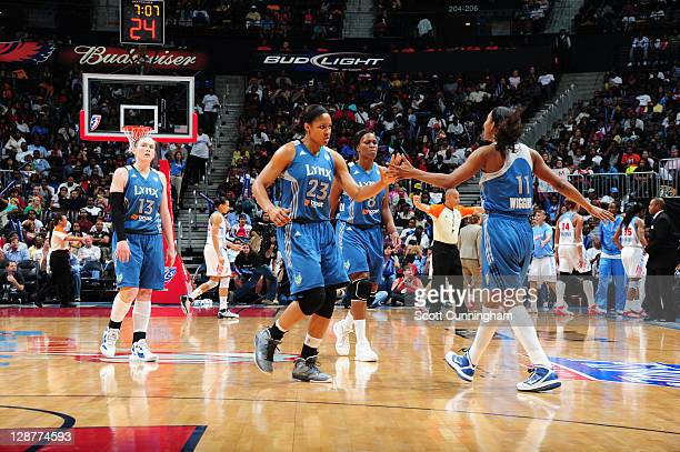Maya Moore and Candice Wiggins of the Minnesota Lynx celebrate during Game Three of the 2011 WNBA Finals against the Atlanta Dream at Philips Arena...