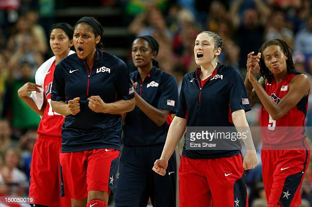 Maya Moore and Lindsay Whalen of United States celebrate on the bench during the Women's Basketball semifinal against Australia on Day 13 of the...