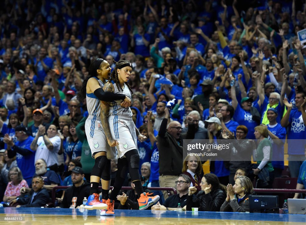 Maya Moore #23 and Seimone Augustus #33 of the Minnesota Lynx celebrate after the Los Angeles Sparks were unable to inbound the ball during the fourth quarter of Game Two of the WNBA Finals on September 26, 2017 at Williams in Minneapolis, Minnesota.
