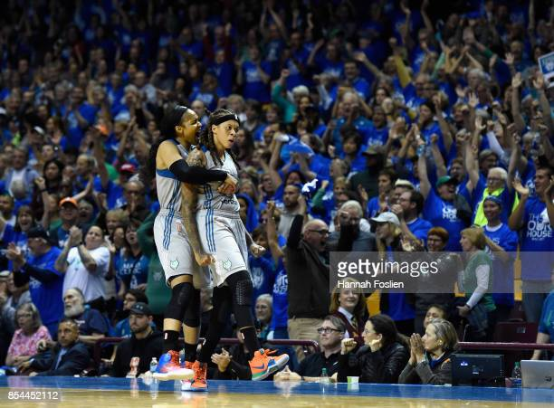 Maya Moore and Seimone Augustus of the Minnesota Lynx celebrate after the Los Angeles Sparks were unable to inbound the ball during the fourth...