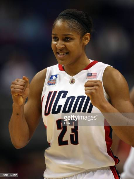 Maya Moore of the Connecticut Huskies celebrates a point on April 5 2009 during the Womens Final Four Semifinals at the Scottrade Center on April 5...