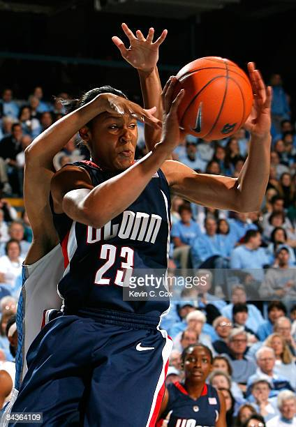Maya Moore of the Connecticut Huskies passes the ball in front of Martina Wood of the North Carolina Tar Heels during the game on January 19, 2009 at...