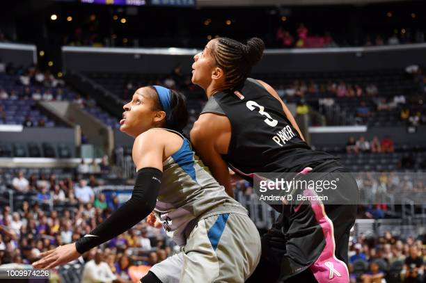 Maya Moore of the Minnesota Lynx and Candace Parker of the Los Angeles Sparks battles for position on August 2 2018 at STAPLES Center in Los Angeles...