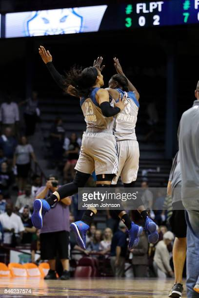 Maya Moore of the Minnesota Lynx and Natasha Howard of the Minnesota Lynx chest bump after the game against the Washington Mystics in Game One of the...