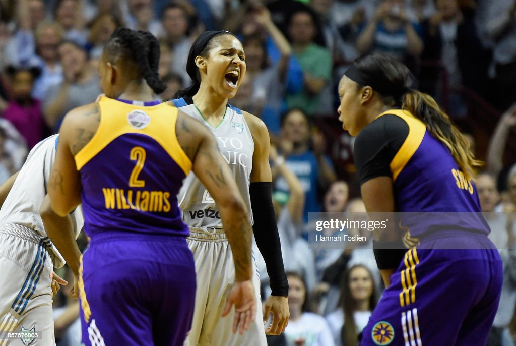 Maya Moore #23 of the Minnesota Lynx celebrates as Riquna Williams #2 and Odyssey Sims #1 of the Los Angeles Sparks react in the final minute of Game Five of the WNBA Finals on October 4, 2017 at Williams in Minneapolis, Minnesota. The Lynx defeated the Sparks 85-76 to win the championship.