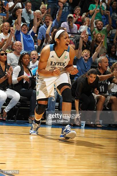 Maya Moore of the Minnesota Lynx celebrates her buzzerbeater shot at the end of the second half against the Tulsa Shock during the WNBA game on...