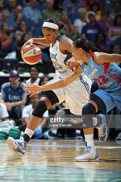 Maya Moore of the Minnesota Lynx dribbles the ball against Armintie Price of the Atlanta Dream during the WNBA game on September 7 2012 at Target...