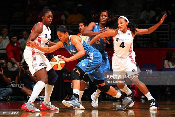 Maya Moore of the Minnesota Lynx drives against Nicky Anosike of the Washington Mystics at the Verizon Center on August 18 2011 in Washington DC NOTE...