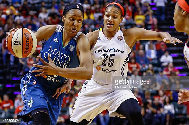 Maya Moore of the Minnesota Lynx drives to the basket against Marissa Coleman of the Indiana Fever at Bankers Life Fieldhouse on October 11, 2015 in...