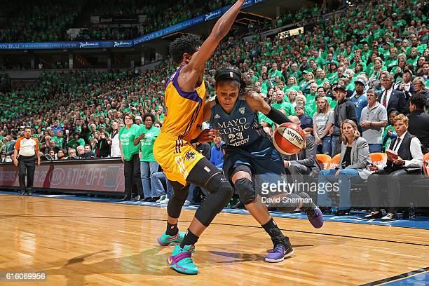 Maya Moore of the Minnesota Lynx drives to the basket against the Los Angeles Sparks during Game Five of the 2016 WNBA Finals on October 20 2016 at...