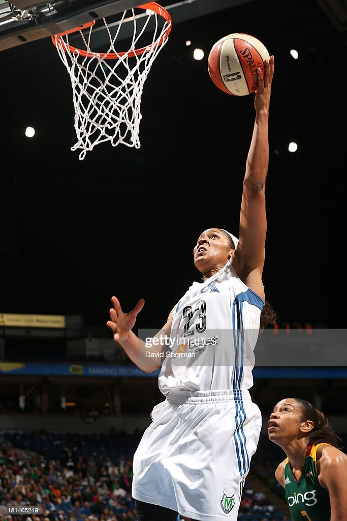 Maya Moore #23 of the Minnesota Lynx goes for the layup against Tina Thompson #7 of the Seattle Storm during the WNBA Western Conference Semifinals Game 1 on September 20, 2013 at Target Center in Minneapolis, Minnesota.