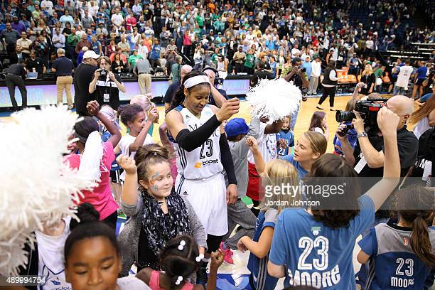 Maya Moore of the Minnesota Lynx greets fans after Game One of the WNBA Western Conference Finals against the Phoenix Mercury on September 24 2015 at...
