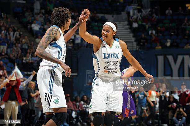 Maya Moore of the Minnesota Lynx high fives teammate Seimone Augustus during the game against the Phoenix Mercury in Game One of the Western...