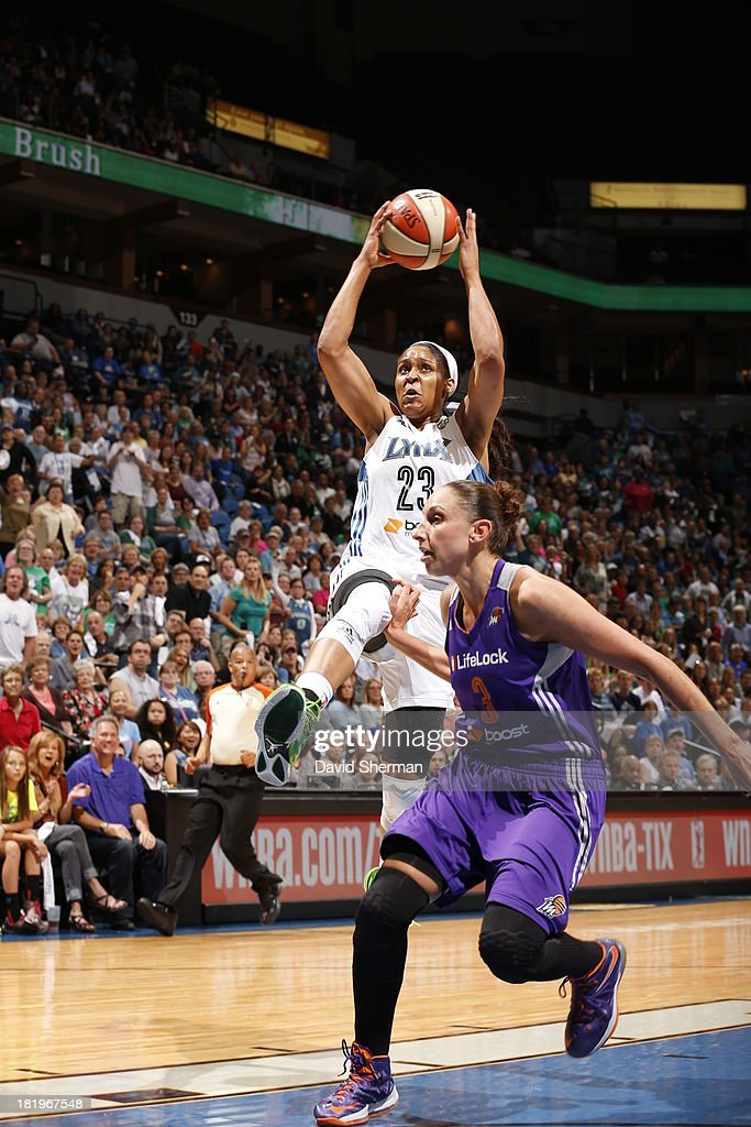 Maya Moore #23 of the Minnesota Lynx shoots against Diana Taurasi #3 of the Phoenix Mercury during the WNBA Western Conference Finals Game 1 on September 26, 2013 at Target Center in Minneapolis, Minnesota.