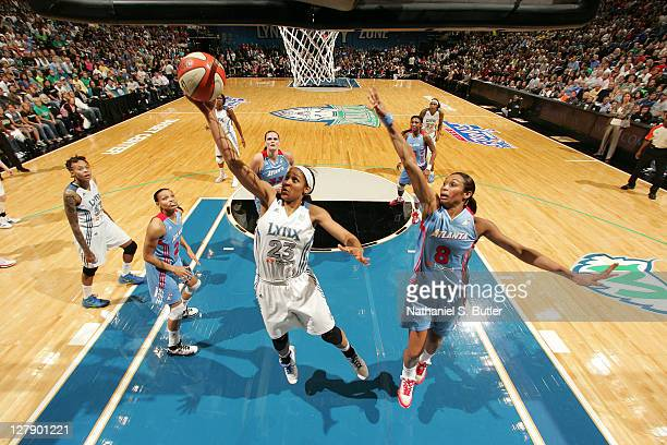 Maya Moore of the Minnesota Lynx shoots against Iziane Castro Marques of the Atlanta Dream in Game One of the 2011 WNBA Finals on October 2 2011 at...