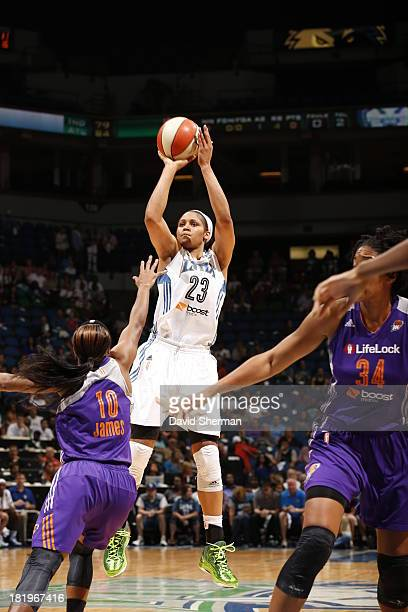 Maya Moore of the Minnesota Lynx shoots against Jasmine James of the Phoenix Mercury during the WNBA Western Conference Finals Game 1 on September 26...