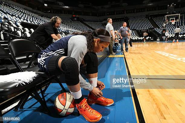 Maya Moore of the Minnesota Lynx ties her shoes for shoot around prior to The 2013 WNBA Finals Game 1 against the Atlanta Dream on October 6 2013 at...