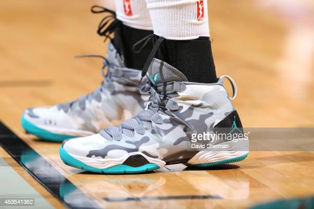 Maya Moore of the Minnesota Lynx wears camouflage shoes in honor of Military Appreciation Night during the WNBA game against the Los Angeles Sparks...
