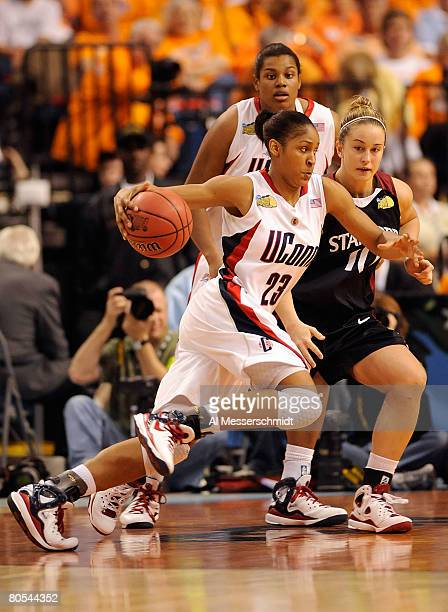 Maya Moore of the UCONN Huskies drives against JJ Hones of the Stanford Cardinal during their National Semifinal Game of the 2008 NCAA Women's Final...