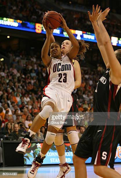 Maya Moore of the UCONN Huskies drives for a shot attempt in the second half against the Stanford Cardinal during their National Semifinal Game of...