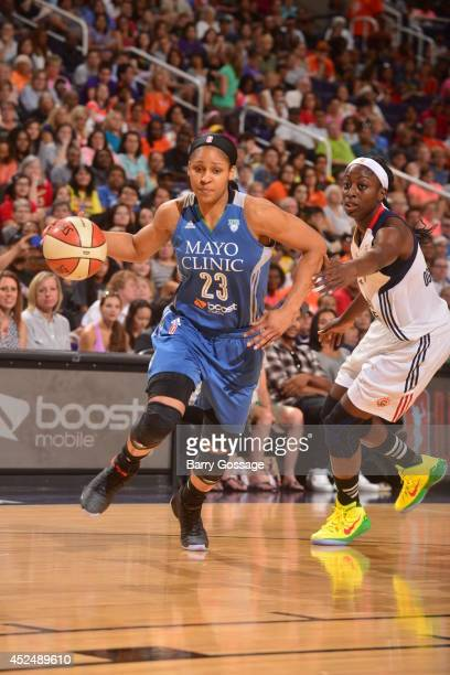 Maya Moore of the Western Conference AllStars dribbles during the 2014 Boost Mobile WNBA AllStar Game on July 19 2014 at US Airways Center in Phoenix...