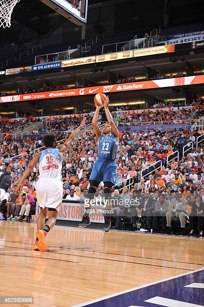 Maya Moore of the Western Conference AllStars shoots against Angel McCoughtry of the Eastern Conference AllStars during the 2014 Boost Mobile WNBA...