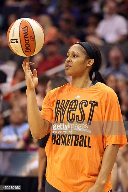 Maya Moore of the Western Conference AllStars spins a ball on her finger during the 2014 Boost Mobile WNBA AllStar Game on July 19 2014 at US Airways...