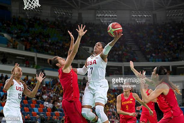 Maya Moore of United States goes to the basket against Laura Nicholls of Spain during the Women's Gold Medal Game between United States and Spain on...