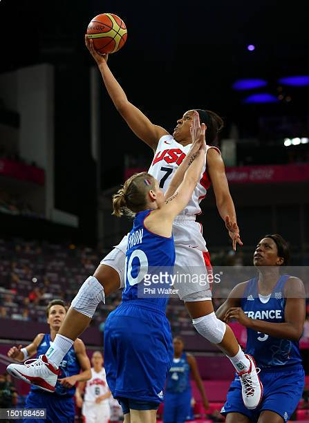 Maya Moore of United States goes up for a shot against Florence Lepron of France in the second half during the Women's Basketball Gold Medal game on...