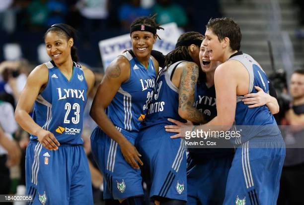 Maya Moore Rebekkah Brunson Seimone Augustus Lindsay Whalen and Janel McCarville of the Minnesota Lynx celebrate in the final seconds of their 8677...