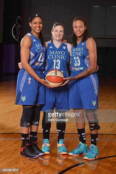 Maya Moore Seimone Augustus and Lindsay Whalen of the Minnesota Lynx poses for a portrait prior to the 2014 Boost Mobile WNBA AllStar Game on July 19...