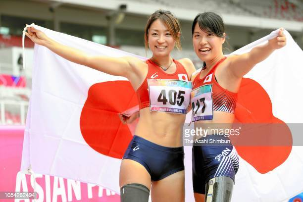 Maya Nakanishi of Japan celebrates winning the gold medal with Tomomi Uzawa after competing in the Women's Long Jump T42-44/61-64 at the GBK Main...