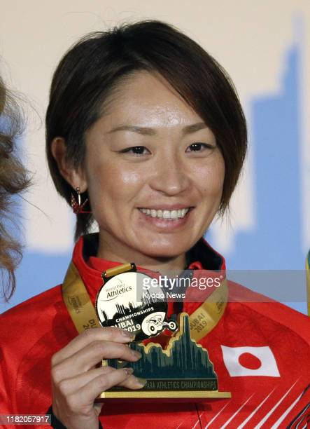 Maya Nakanishi of Japan, gold medalist in the World Para Athletics Championships women's T64 long jump, poses for a photo at the medal ceremony in...